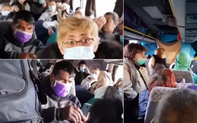 [VIDEO] Zeci de români întorși din străinătate, înghesuiți în autocar spre punctul de triaj