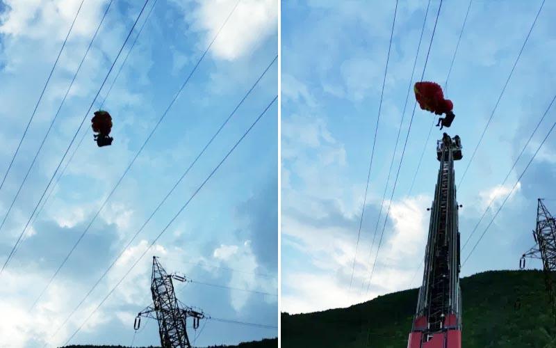 [VIDEO] Intervenție dificilă pentru salvarea unui parapantist blocat în firele de electricitate.